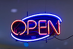 Neon OPEN sign in store window. Product Information on indoor Evertron Neon Power Supply box readable viewed at full size