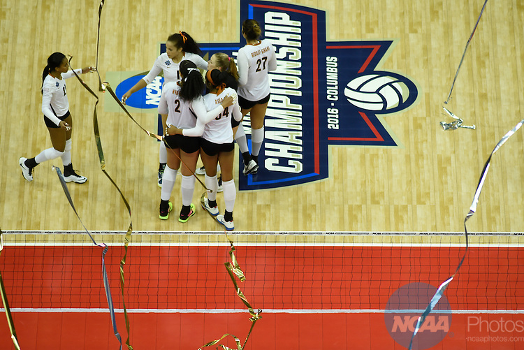 COLUMBUS, OH - DECEMBER 17:  University of Texas players comfort each other as the streamers fall during the Division I Women's Volleyball Championship held at Nationwide Arena on December 17, 2016 in Columbus, Ohio.  Stanford defeated Texas 3-1 to win the national title. (Photo by Jamie Schwaberow/NCAA Photos via Getty Images)