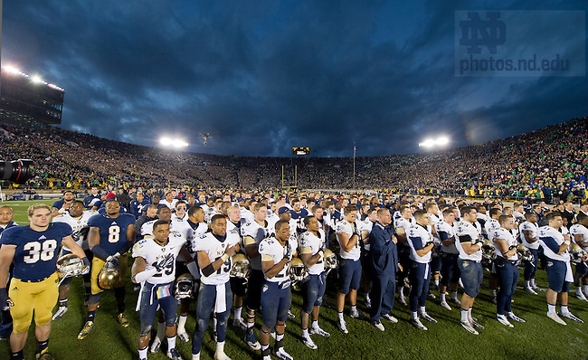 Nov. 2, 2013; The football team stands with Navy as the Midshipmen sing their Alma Mater after losing to the Irish 38-34.<br /> <br /> Photo by Matt Cashore