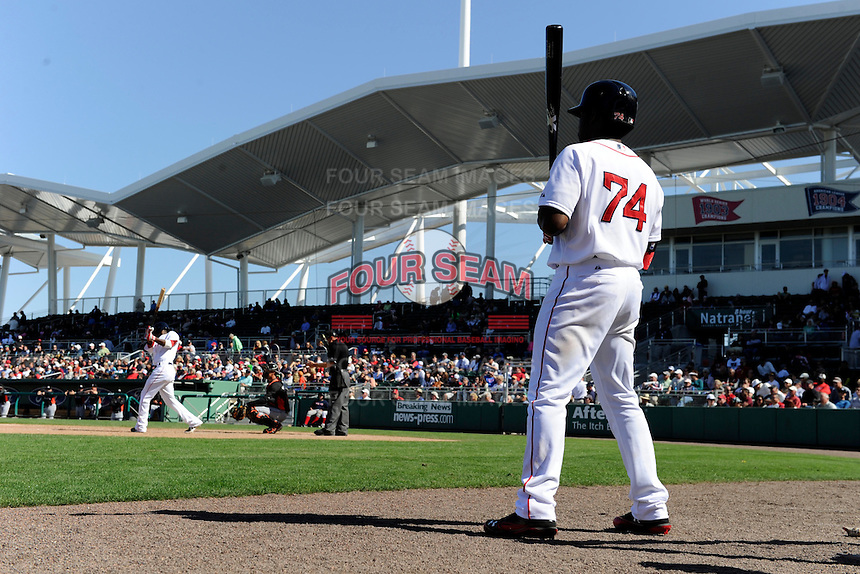Boston Red Sox outfielder Jackie Bradley Jr. #74 waits on deck during a Spring Training game against the Miami Marlins at JetBlue Park on March 27, 2013 in Fort Myers, Florida.  Miami defeated Boston 5-1.  (Mike Janes/Four Seam Images)