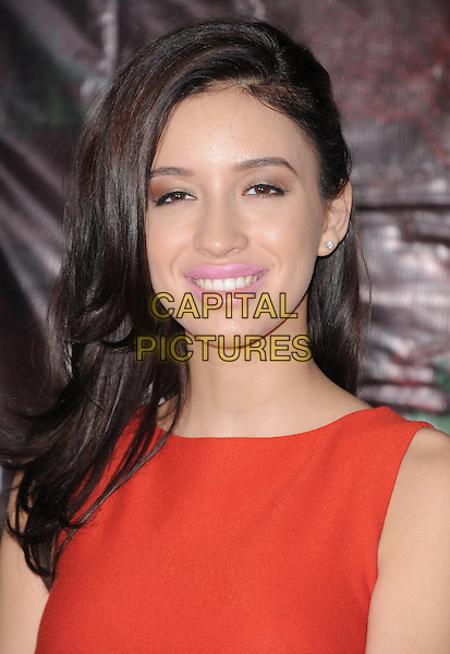 Christian Serratos .attending the Cirque du Soleil OVO Opening Night held at The Santa Monica Pier in Santa Monica, California, USA,.January 20th 2012..portrait headshot sleeveless pink lipstick beauty make-up red smiling .CAP/RKE/DVS.©DVS/RockinExposures/Capital Pictures.