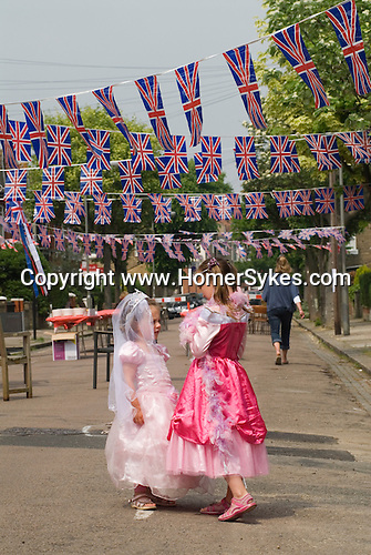 Preteen girls dress up as a Princess. Getting ready for a Royal Wedding Street party. London 2011.