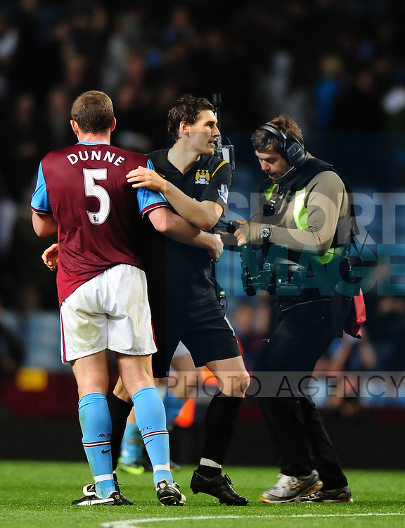 Richard Dunne of Aston Villa and Gareth Barry of Manchester City at the end of the match