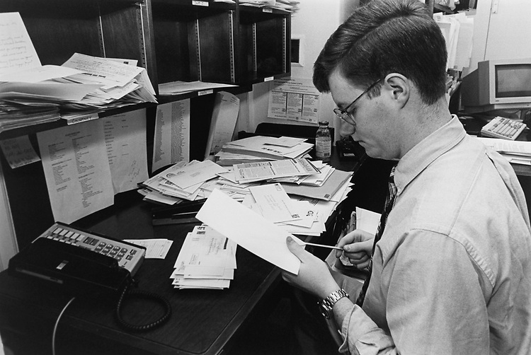 Staff Member Jay Bennett intern in Rep. Jim Saxton's office opens the mail in April 1996. (Photo by Maureen Keating/CQ Roll Call via Getty Images)