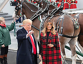 United States President Donald J. Trump waves to the cameras as he and and First lady Melania Trump accept the White House Christmas tree on the North Driveway of the White House in Washington, DC on Monday, November 19, 2018. The 2018 White House Christmas Tree will arrive as in previous years by horse and carriage on the North Portico. The tree will be displayed in the Blue Room of the White House. <br /> Credit: Ron Sachs / CNP<br /> (RESTRICTION: NO New York or New Jersey Newspapers or newspapers within a 75 mile radius of New York City)