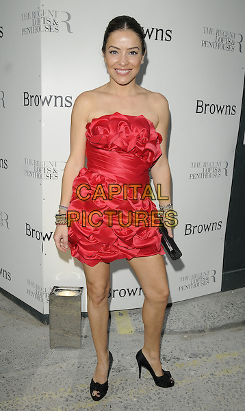 ELEN RIVAS .At the Browns 40th Anniversary dinner & auction, the Regent Penthouse & Lofts, London, England, UK, May 20th 2010..full length red strapless dress peep toe black shoes layered ruffles ruffle ruched  clutch bag.CAP/CAN.©Can Nguyen/Capital Pictures.