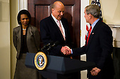 Washington, D.C. - January 5, 2007 -- United States President George W. Bush shakes hands with Director of National Intelligence (DNI) John Negroponte after the announcement that Vice Admiral Mike McConnell will replace Negroponte as DNI. Negroponte will become the Deputy Secretary of State under Condoleezza Rice. <br /> Credit: Jay L. Clendenin - Pool via CNP