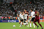 08 July 2006: Marcell Jansen (GER) (2) digs for the ball as Bastian Schweinsteiger (GER) (7) keeps Cristiano Ronaldo (POR) (17) away from the chase. Germany defeated Portugal 3-1 at the Gottlieb-Daimler Stadion in Stuttgart, Germany in match 63, the third-place game, of the 2006 FIFA World Cup.