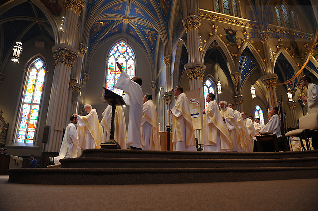 Holy Cross Priests lay their hands on the newly ordained priests at ordination mass, March 2008.