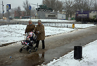 Two women push a baby pram in front of a tank in the town of Ludinovo, near the city of Kaluga southwest of Moscow. .Picture by Justin Jin.