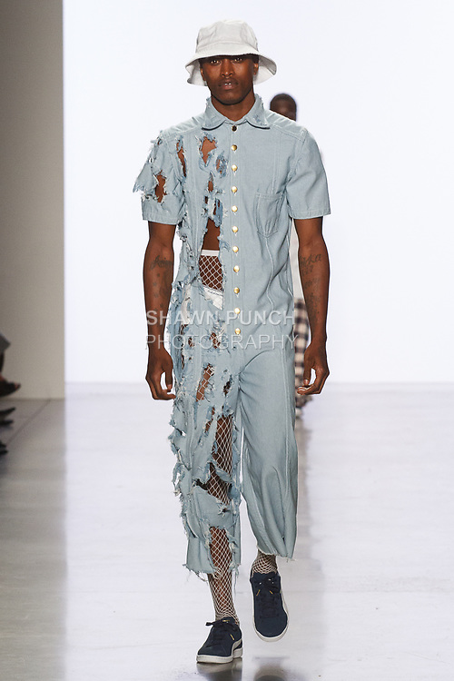 Model walks runway in an outfit by Olivia Mains, for the 2017 Pratt fashion show on May 4, 2017 at Spring Studios in New York City.