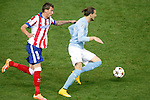 Atletico de Madrid´s Mandzukic (L) and Malmo´s Eriksson during Champions League soccer match between Atletico de Madrid and Malmo at Vicente Calderon stadium in Madrid, Spain. October 22, 2014. (ALTERPHOTOS/Victor Blanco)