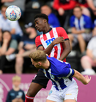 Lincoln City's Jordan Adebayo-Smith vies for possession with Sheffield Wednesday's Tom Lees<br /> <br /> Photographer Chris Vaughan/CameraSport<br /> <br /> Football Pre-Season Friendly - Lincoln City v Sheffield Wednesday - Saturday July 13th 2019 - Sincil Bank - Lincoln<br /> <br /> World Copyright © 2019 CameraSport. All rights reserved. 43 Linden Ave. Countesthorpe. Leicester. England. LE8 5PG - Tel: +44 (0) 116 277 4147 - admin@camerasport.com - www.camerasport.com