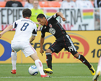 DC United midfielder Andy Najar (14) goes against Real Salt Lake midfielder Will Johnson (8)  DC United and Real Salt Lake tied 0-0 at RFK Stadium, Wednesday  June 2  2010.