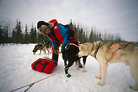 Libby Riddles Puts Booties on Sled Dog Ophir Chkpt AK Iditarod 1989 Winter