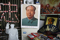 CHINA. Hubei Province. Wuhan.  Mao Zedong paraphenalia in a tourist shop in the gardens of The Yellow Crane Tower which looks over the Yangtze and the city of Wuhan.  2008.