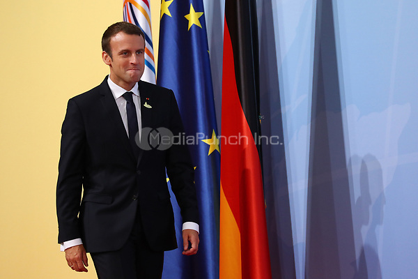 German chancellor Angela Merkel greets the French president Emmanuel Macron at the G20 summit in Hamburg, Germany, 7 July 2017. The heads of the governments of the G20 group of countries are meeting in Hamburg on the 7-8 July 2017. Photo: Christian Charisius/dpa /MediaPunch ***FOR USA ONLY***
