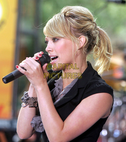 HILARY DUFF.Performs at the 'Today' Show Summer Concert Series,.NBC Studios, Rockefeller Plaza,.New York, 18th August 2005.portrait headshot stage music gig singer grey gray ruffle neck top chiffon black small fitted jacket bead bracelet microphone hair up messy fringe singing red nail polish varnish.www.capitalpictures.com.sales@capitalpictures.com.© Capital Pictures.