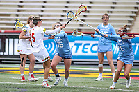 College Park, MD - February 24, 2019: Maryland Terrapins midfielder Jen Giles (5) scores a goal during the game between North Carolina and Maryland at  Capital One Field at Maryland Stadium in College Park, MD.  (Photo by Elliott Brown/Media Images International)