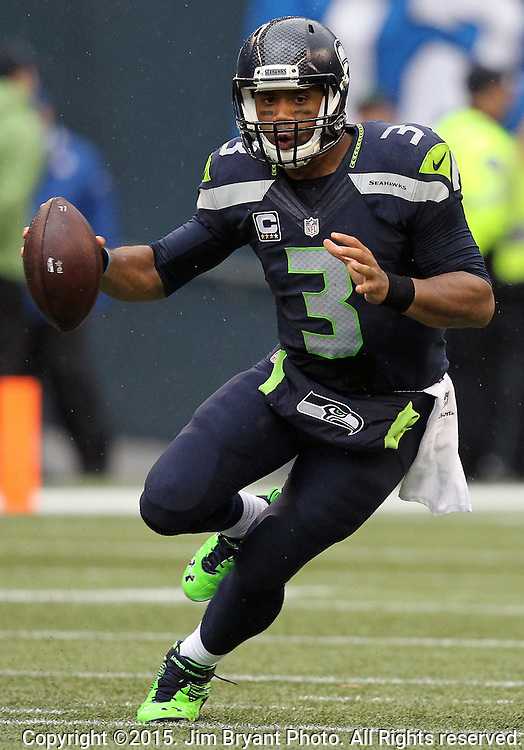 Seattle Seahawks  Russell Wilson scrambles away from the Carolina Panthers defense at CenturyLink Field in Seattle on October 18, 2015. The Panthers came from behind with 32 seconds remaining in the 4th Quarter to beat the Seahawks 27-23.  ©2015 Jim Bryant Photography. All Rights Reserved.