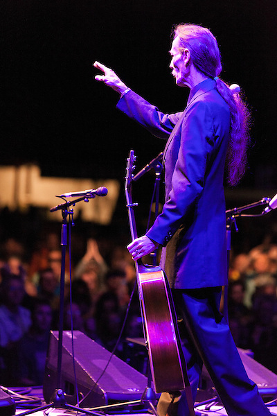 September 27, 2013. Raleigh, North Carolina.<br />  Tony Rice waved to the crowd before leaving the stage at Wide Open Bluegrass, where he played to a sold out crowd with a cast of bluegrass greats that included Del McCoury, Sam Bush, Bela Fleck, Jerry Douglas, and Mark Schatz.<br />  After being inducted into the International Bluegrass Music Hall of Fame the night before, guitar legend Tony Rice took the stage with many notable friends for a sold out show at the Red Hat Amphitheater