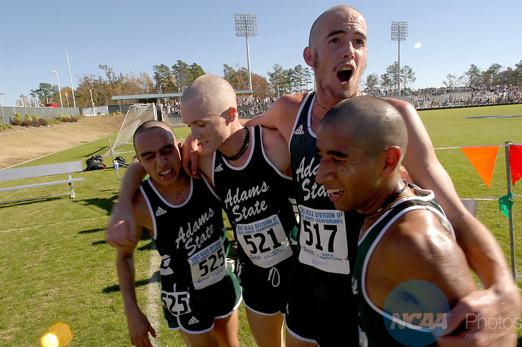 22 November 2003:  Matthew Levassiur (517) of Adams State celebrates with teammates Jesus Solis (525), Joshua Merrick (521) and Celedino Rodriguez (right) after the NCAA Men's Division 2 Cross Country Championships held at SAS Soccer Park in Cary, North Carolina.  Adams State captured both the Men's and Women's team titles.  Andres Alonso/NCAA Photos