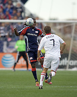 New England Revolution midfielder Shalrie Joseph (21) receives pass as Chicago Fire midfielder Logan Pause (7) closes. The New England Revolution out scored the Chicago Fire, 2-1, in Game 1 of the Eastern Conference Semifinal Series at Gillette Stadium on November 1, 2009.