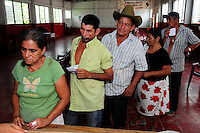 Members of the community of Ciudad Romero, queue for prescriptions following consultations with members of the health team as part of a series of investigations carried out by the 'Nefrolempa' project into the high incidence of chronic renal failure in the region.<br />