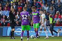 Referee Gavin Ward shows a yellow card to Marley Watkins of Bristol City (3rd L) for his foul against Barrie McKay of Swansea City (R) during the Sky Bet Championship match between Swansea City and Bristol City at the Liberty Stadium, Swansea, Wales, UK. Saturday 25 August 2018