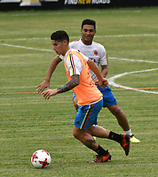 BARRANQUILLA - COLOMBIA - 02 - 10 - 2017: James Rodríguez, (Izq.) y Teofilo Gutierrez (Der.), jugadores de la Selección Colombia durante entreno en las canchas del Polideportivo Universidad Autonoma del Caribe. El equipo colombiano se prepara en Barranquilla para el partido contra el seleccionado de Paraguay el 05 de octubre, partido clasificatorio a la Copa Mundial de la FIFA Rusia 2018. / James Rodríguez, (L) and Teofilo Gutierrez (R), Colombia national team players, during a training in the grounds of the Sports Center of Autonoma del Caribe University. Colombia team prepares in Barranquilla for the match against the national team of Paraguay on October 05, qualifying for the FIFA World Cup Russia 2018. Photo: VizzorImage / Luis Ramirez/ Staff.