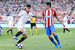 Atletico de Madrid's Stefan Savic and Sevilla's Carlos Joaquin Correa during La Liga match between Atletico de Madrid and Sevilla CF at Vicente Calderon Stadium in Madrid, Spain. March 19, 2017. (ALTERPHOTOS/BorjaB.Hojas)