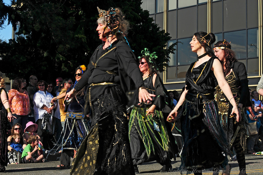 Procession of the Species participants entertain the crowd in Olympia, Washington.