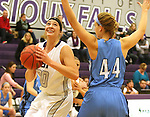 SIOUX FALLS, SD - DECEMBER 5:  Sam Knecht #50 from the University of Sioux Falls makes a move against Olivia Winkler #44 from Upper Iowa in the first half of their game Friday night at the Stewart Center.  (Photo by Dave Eggen/inertia)