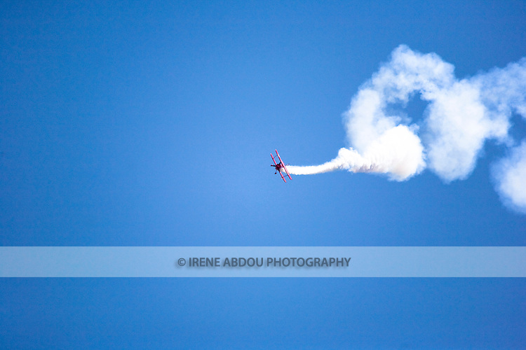 A plane performs aerobatics before the large crowd at the 2008 Joint Service Open House air show at Andrews Air Force Base in Suitland, Maryland.