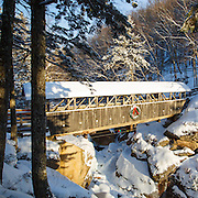 This is the image for the month of December in the 2015 White Mountains New Hampshire calendar. Sentinel Pine Covered Bridge in Franconia Notch State Park in Lincoln, New Hampshire USA. This footbridge crosses over the Pemigewasset River. It can be purchased here: http://bit.ly/1audUBp