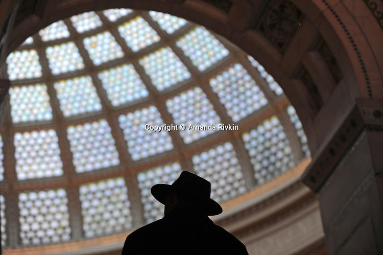 A man listens to a concert at Preston Bradley hall inside the Chicago Public Library and Cultural Center, a Chicago landmark, at 78 E. Washington in Chicago, Illinois on March 23, 2009.