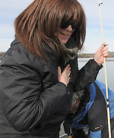 NWA Democrat-Gazette/FLIP PUTTHOFF <br /> Denise Rivers catches her breath Jan. 16, 2016 after catching a trophy-sized striped bass at Beaer Lake.