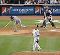 Hiroki Kuroda (Yankees), Munenori Kawasaki (Blue Jays),.MAY 17, 2013 - MLB :.Hiroki Kuroda of the New York Yankees watches the ball as Munenori Kawasaki of the Toronto Blue Jays runs to first base during the baseball game at Yankee Stadium in The Bronx, New York, United States. (Photo by AFLO)