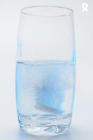 Effervescent Aspirin dissolving in glass of water, Studio (Licence this image exclusively with Getty: http://www.gettyimages.com/detail/82064694 )