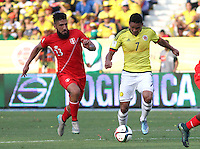 BARRANQUILLA  - COLOMBIA - 8-10-2015: Carlos Bacca jugador de la seleccion Colombia  disputa el balon con Carlos Ascues de la seleccion Peru durante primer partido  por por las eliminatorias al mundial de Rusia 2018 jugado en el estadio Metropolitano Roberto Melendez  / :Carlos Bacca  player of Colombia  fights for the ball with Carlos Ascues of selection of Peru during first qualifying match for the 2018 World Cup Russia played at the Estadio Metropolitano Roberto Melendez. Photo: VizzorImage / Felipe Caicedo / Staff.