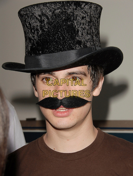 BRENDON of PANIC! AT THE DISCO.backstage at The 106.7 KROQ Weenie Roast 2006 held at The Verizon Wireless Ampitheatre in Irvine, California, USA, May 13th 2006..portrait headshot hat moustache funny.Ref: DVS.www.capitalpictures.com.sales@capitalpictures.com.©Debbie VanStory/Capital Pictures