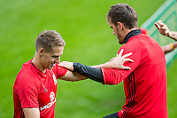 Dave Edwards, who has withdrawn from the squad and been replaced by Shaun MacDonald, stretches with Emyr Huws during the Wales open Training session ahead of the opening FIFA World Cup 2018 Qualification match against Moldova at The Vale Resort, Cardiff, Wales on 31 August 2016. Photo by Mark  Hawkins / PRiME Media Images.