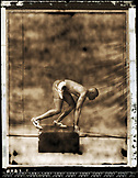 USA, California, USC track and field athlete in starting position, Los Angeles (B&W)