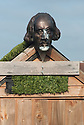 Allotment shed with artificial turf roof and bust of William Shakespeare.