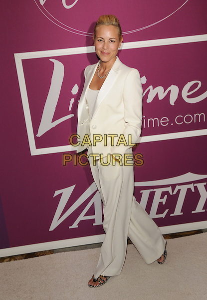 MARIA BELLO .at Variety's 1st Annual Power Of Women held at The Beverly Wilshire Hotel in Beverly Hills, California, USA, .September 24th 2009.                                                                                      .full length white trouser suit  hands in pockets trousers wide leg sandals walking .CAP/DVS.©DVS/RockinExposures/Capital Pictures