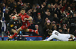 Wales scrum half Rhys Webb leaves England wing Jonny May trailing to score the first try of the match.<br /> 2015 RBS 6 Nations<br /> Wales v England<br /> Millennium Stadium <br /> 06.02.15<br /> ©Steve Pope -SPORTINGWALES
