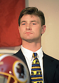 Newly acquired Washington Redskins quarterback Brad Johnson (14) appears at Redskins Park in Ashburn, Virginia for a press conference following his trade from the Minnesota Vikinga for a 1st & 3rd round draft choice in 1999 and a 2nd round draft choice in 2000 on February 16, 1999. <br /> Credit: Arnie Sachs / CNP