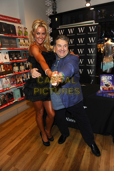 Natalie Lowe & Russell Grant .Strictly Come Dancing - Annual Book Signing, Waterstone's, Oxford Street, London. England..November 23rd, 2011.full length black trousers dress suit jacket blue tall short holding hands dance .CAP/CJ.©Chris Joseph/Capital Pictures.