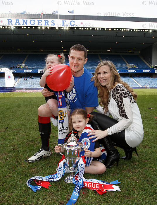 Jon Daly and family with the league championship trophy