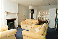 BNPS.co.uk (01202 558833)<br /> Pic: RachelAdams/BNPS<br /> <br /> Pictured - the living area<br /> <br /> A cottage immortalised in the famous Hovis TV advert featuring a young boy struggling to push his bike up a steep cobbled street is up for sale.<br /> <br /> The bungalow at Gold Hill, Shaftesbury, Dorset, was the home of 'Old Ma Peggotty' in the ad - the last house on the bakery boy's round.<br /> <br /> The 1973 commercial, directed by Ridley Scott, was voted Britain's all-time favourite TV advert in 2006.<br /> <br /> In it the lad is heard to say that delivering bread to the house on top of the hill 't'was like taking bread to the top of the world.'